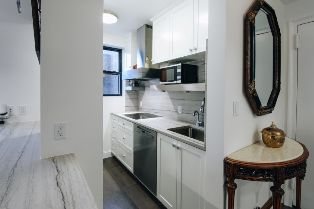 Cascade white painted cabinets and stainless steel appliances