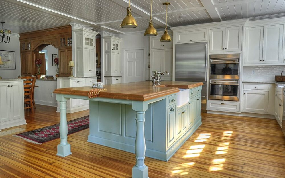 Custom Plain and Fancy Cabinetry and a natural cherry countertop