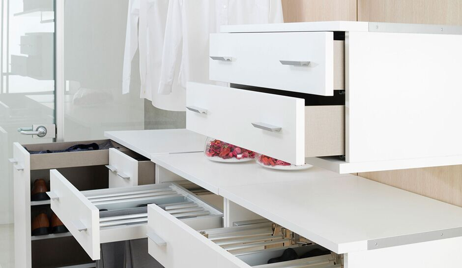 Floating white closet drawers