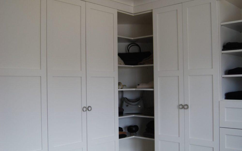 White closet corner shelves