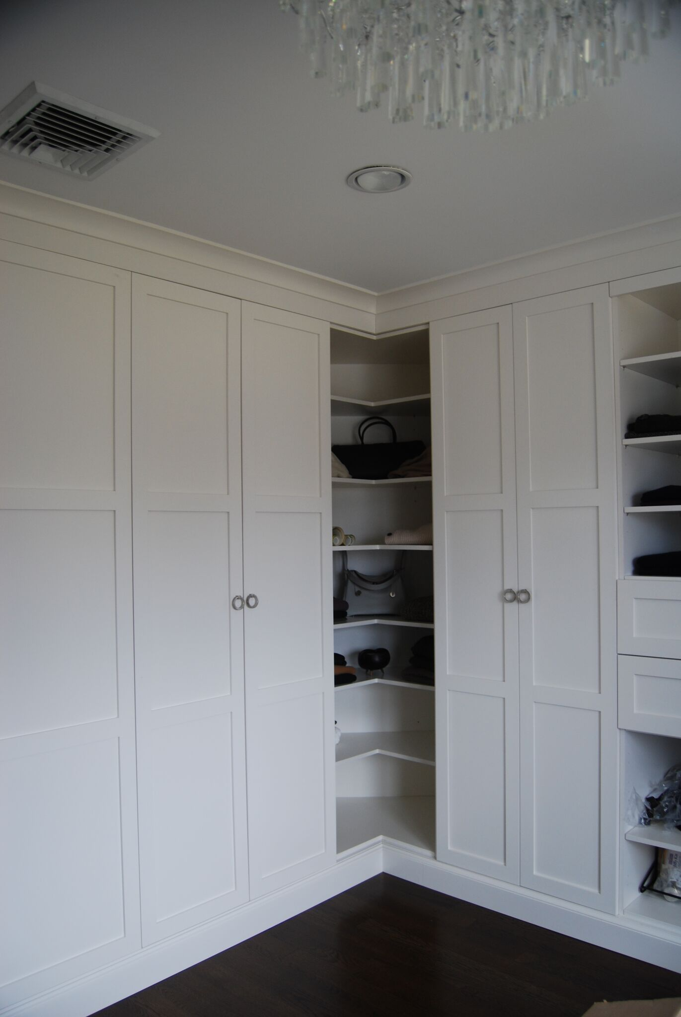 White closet corner shelves